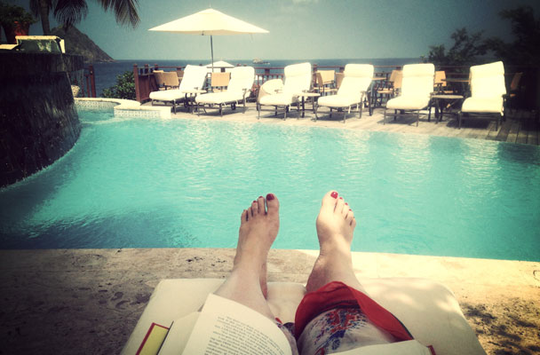 The author poolside, nourishing her natal Moon with words and travel.